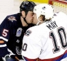 Funny Pictures - Hockey Kiss