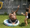 Funny Pictures - Fat Guy in a Kid's Pool