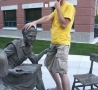 Funny Pictures - Happy With Statue