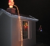 Christmas Pictures - Santa Peeing Off the Roof